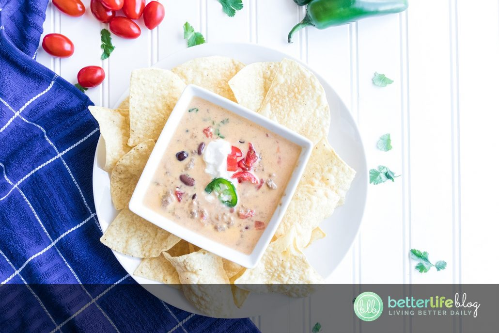 This Beer Cheese Queso Dip is one for the books! Serve it with your favorite nachos and you've got a summer appetizer your guests will constantly talk about (and request!) #quesodip