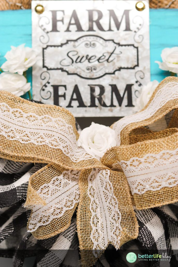 This Dollar Tree Farmhouse Wreath is easy to put together and the result is breathtaking! You can redecorate your home without breaking the bank with this simple and unique DIY. #DIYwreath