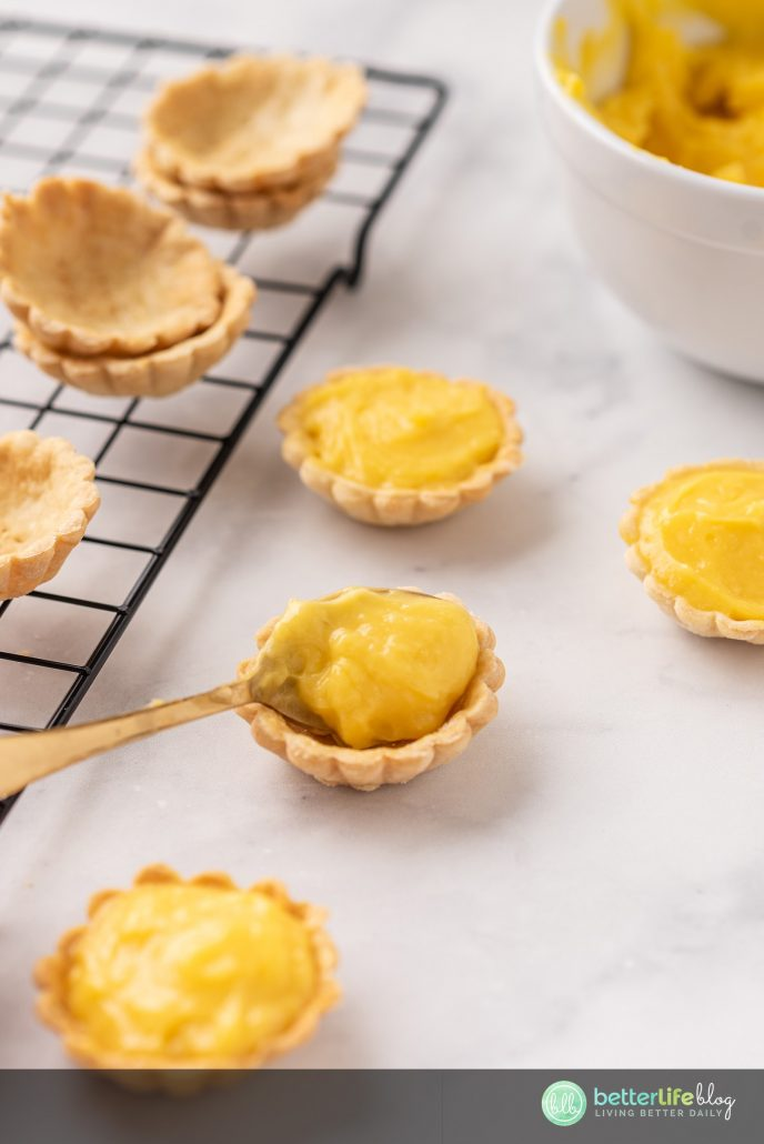 These Lemon Curd Bites are the cutest desserts I have ever seen! With everything made from scratch, your family will be giving you a blue ribbon the moment they bite into them.