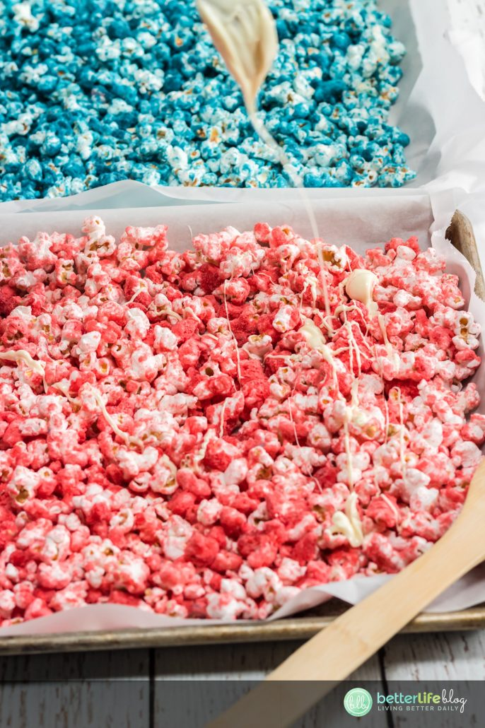 This Patriotic Popcorn is bright, colorful and delicious - it seriously makes the perfect snack for the Fourth of July! Why not treat your family with this sweet treat that boasts our nation's beautiful colors?!