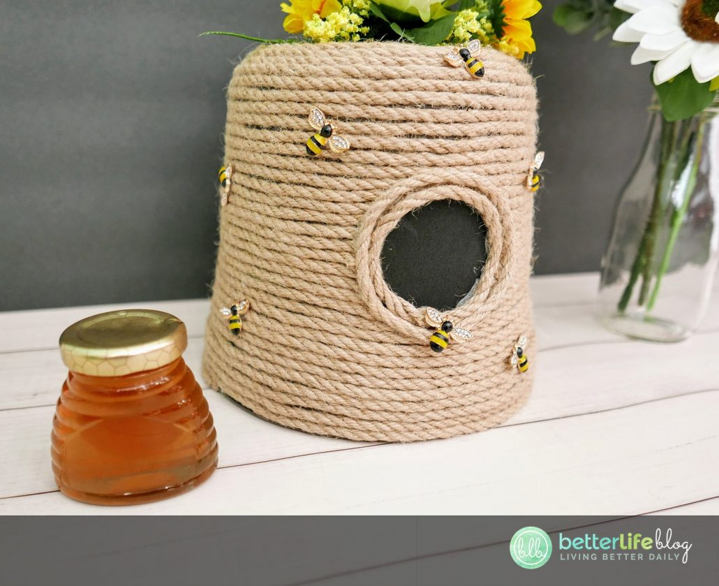 This DIY Bee Hive Craft is made with a simple flower pot and craft jute rope. All it takes is some imagination - and a lot of hot glue! This DIY is super simple and extremely cute!