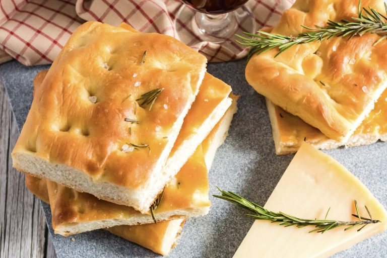 This Focaccia Bread Recipe is simple and easy! Infused with fresh rosemary and quality olive oil, this focaccia bread is gorgeous and tasty!