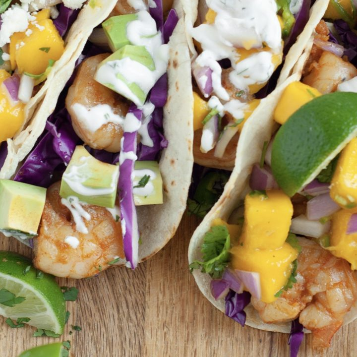 My Shrimp Tacos with mango salsa are out of this world! In these tacos, you'll find Sriracha-infused shrimp, a smooth cilantro cream, and a mouthwatering homemade mango salsa. Everything is made from scratch and I'm showing you how you can make your own with my easy recipe!