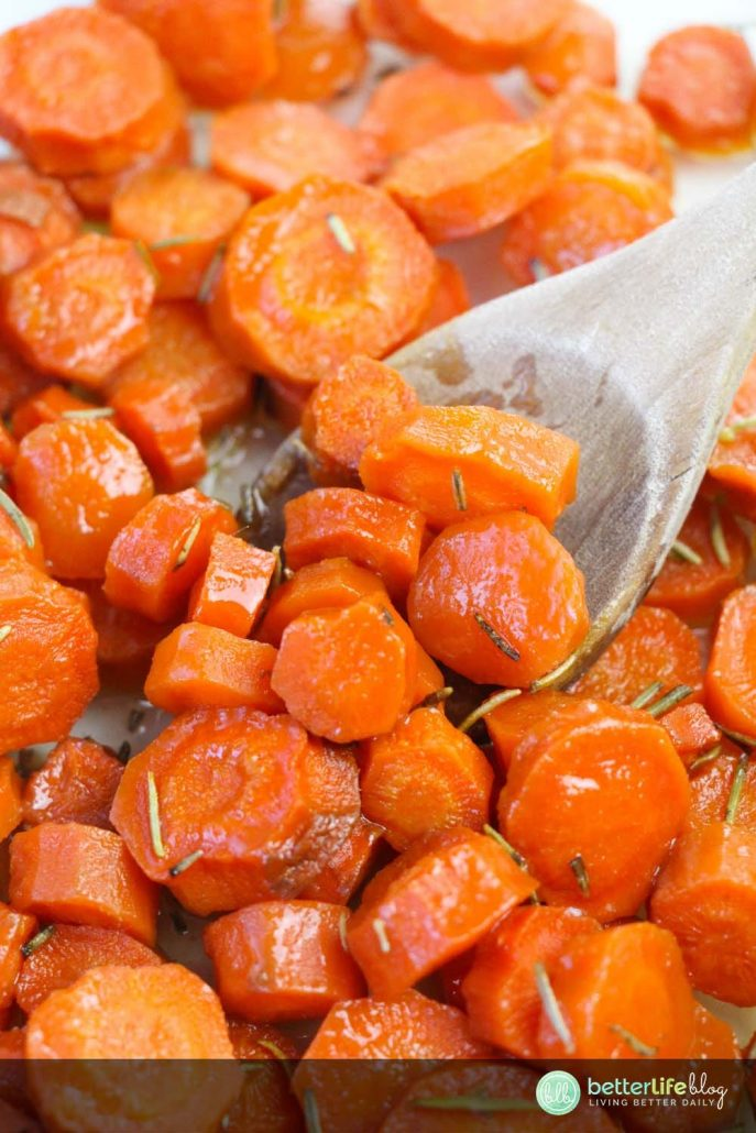 These Honey Roasted Glazed Carrots are the side dish your main meal absolutely needs. Coated with honey and sprinkled with rosemary, this side is full of flavor and super easy to make!