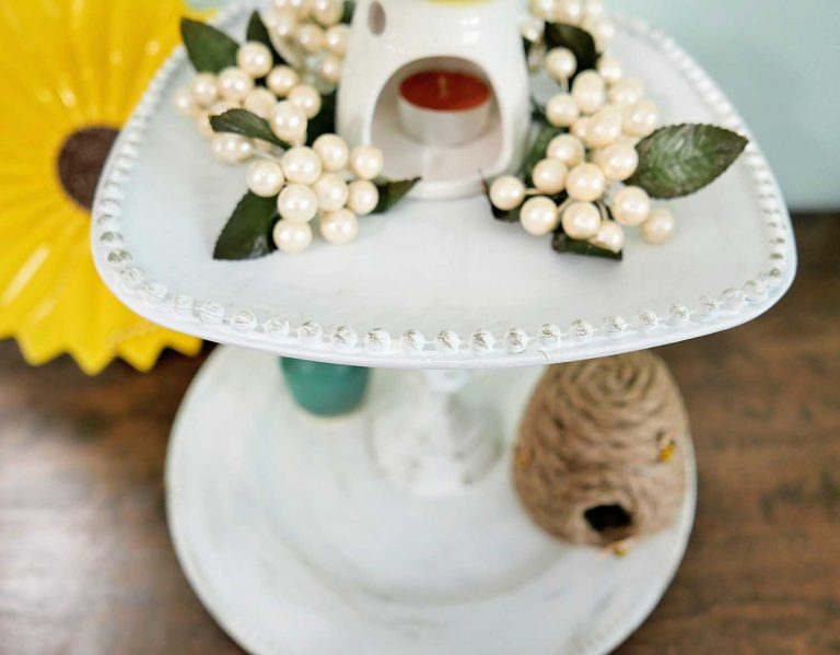 This Dollar Tree Tiered Tray has a beautiful, rustic feel - giving my living room that touch of vintage elegance I always wanted. You wouldn't even believe that it's made with products from my local Dollar Tree - and a 100% DIY project. Check out how I made it!