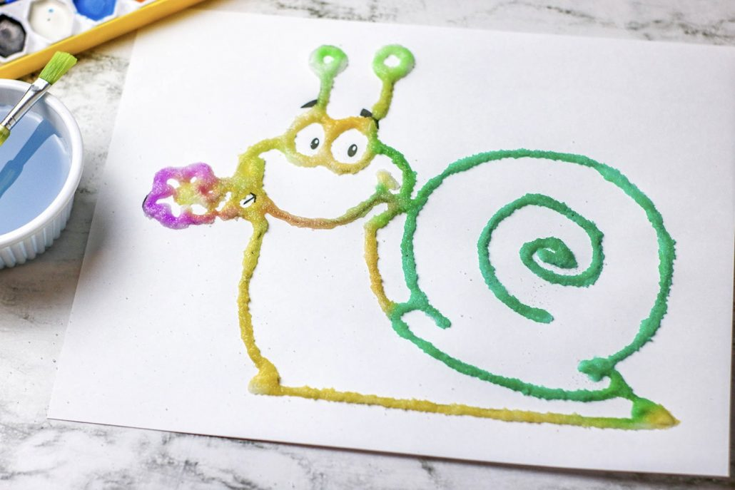 This Kids Salt Painting activity is one for the books! Super cute and very easy to make - your kids will love using all of the supplies required to complete this craft. I mean, come on: how can they resist white glue, salt and tons of paint?!