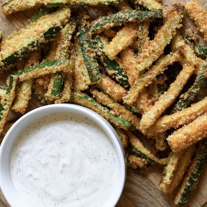These oven-baked zucchini fries are SO easy to whip-up and are full of delicious flavor. Plus, paired with my homemade Avocado Ranch, your family will gobble them up in minutes!