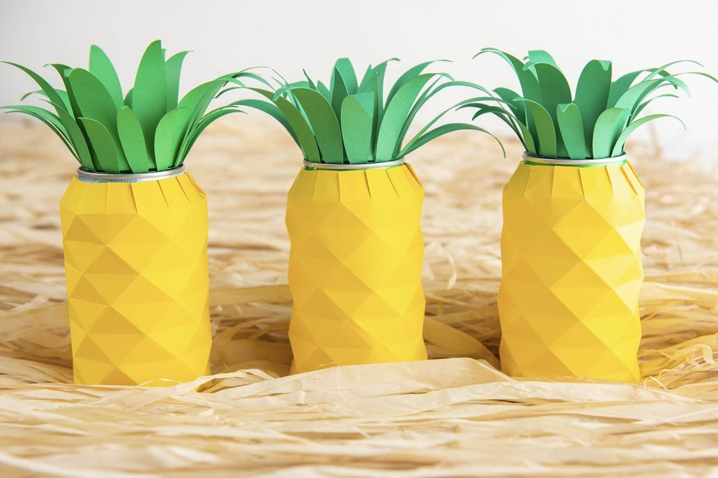 This Cricut craft is perfect for any Hawaiian-themed party. Learn how to make this Pineapple Soda Can decoration with cardstock and leftover soda cans.