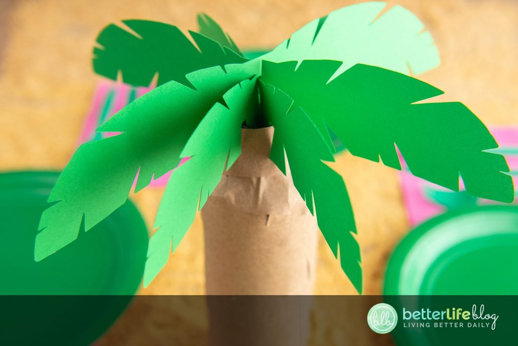 This Palm Tree Centerpiece is the perfect addition for your upcoming luau-themed party. What's best is that it's made using the oh-so-impressive Cricut machine. Follow my easy steps so you can DIY this cute paper craft yourself!