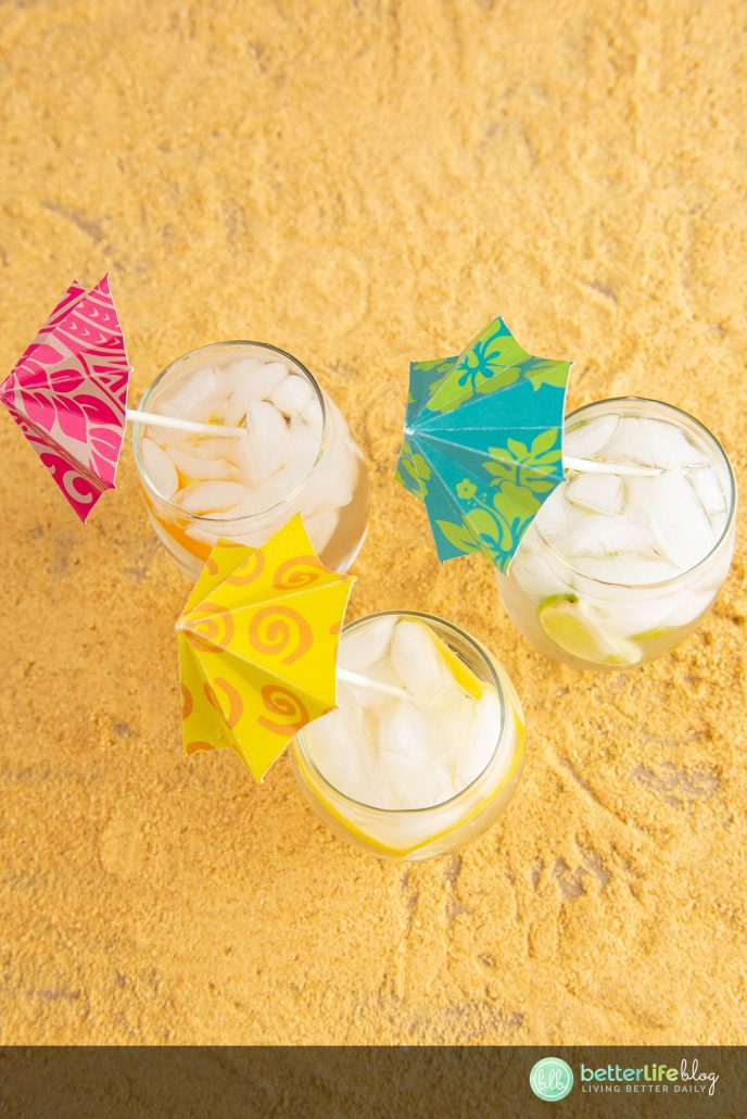 These Luau Parasol Drink Umbrellas are ultra-cute and are made with the help of a Cricut machine. Can you believe it?! They're fun, colorful and give your cocktails tons of character.