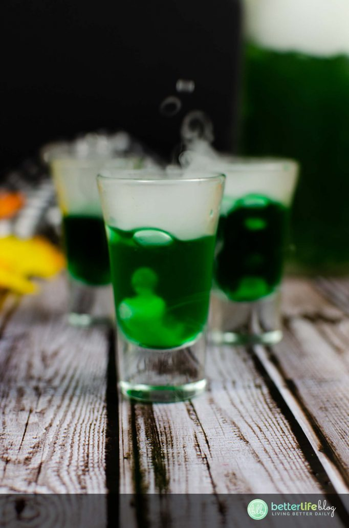 """Double, double, toil and trouble!"" This Halloween Witch's Brew Cocktail will have you cackling with evil laughter! Well, actually… it'll just get you REALLY excited for Halloween (and that's never a bad thing!)."