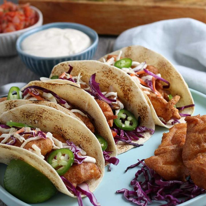 My Delicious Baja Fish Tacos Recipe is one for the books! They're covered in a homemade batter and fried/crisped to perfection. Every bite is filled with flavor and your family will love them for your weekly Taco Tuesday nights.