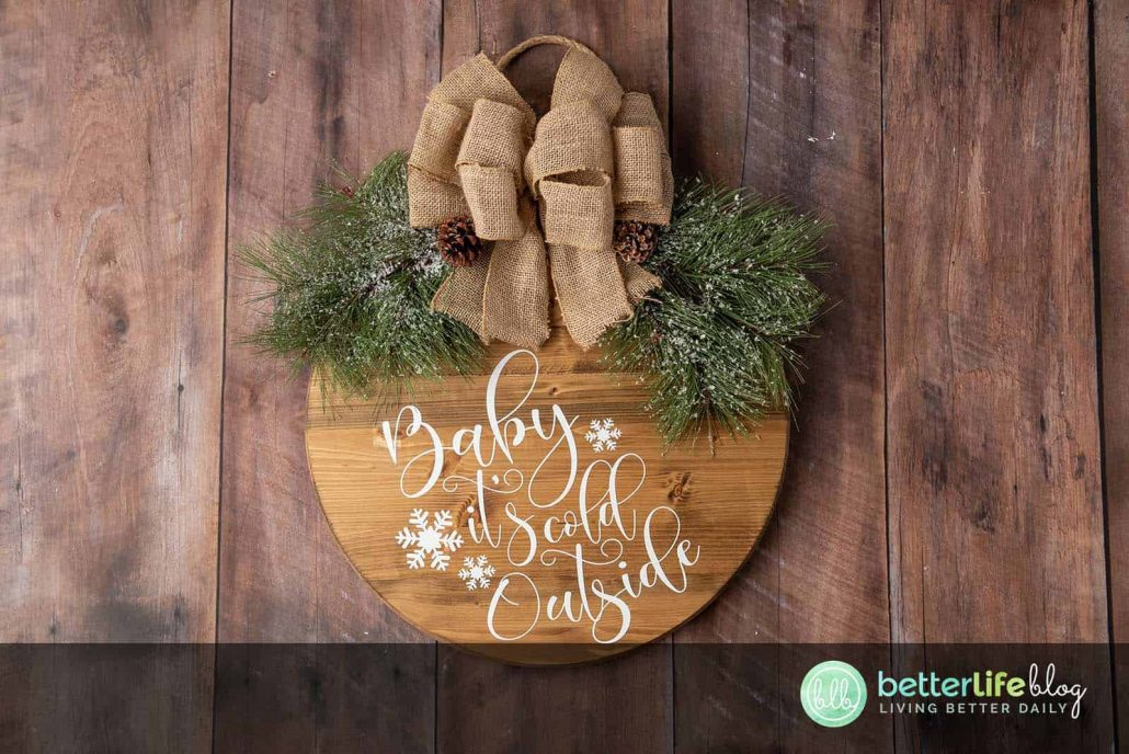 Our Farmhouse Christmas Door Sign is elegant and a offers a beautiful, rustic touch to your home. Made using a Cricut Machine, this door sign is absolutely perfect for the holiday season.