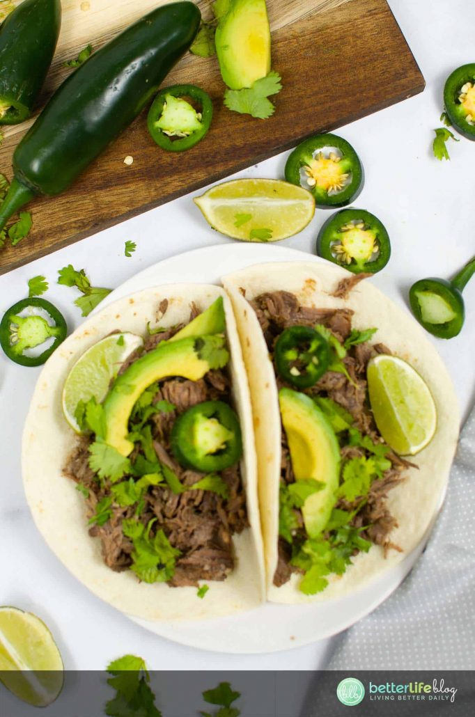 My Instant Pot Barbacoa Chipotle Copycat recipe tastes like the real deal! It's juicy, tender and tastes amazing wrapped in a soft-shell taco, topped with cilantro and lime.