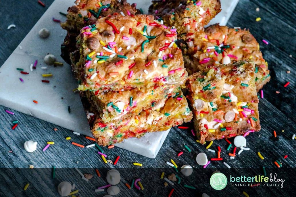 My Easy Cake Batter Blondies are a breeze to whip-up and you'll be impressed by the sweet results! These blondies are garnished with a hefty amount of sprinkles and white chocolate chips. There's deliciousness in every single bite and you'll want to make a batch for your family - stat!