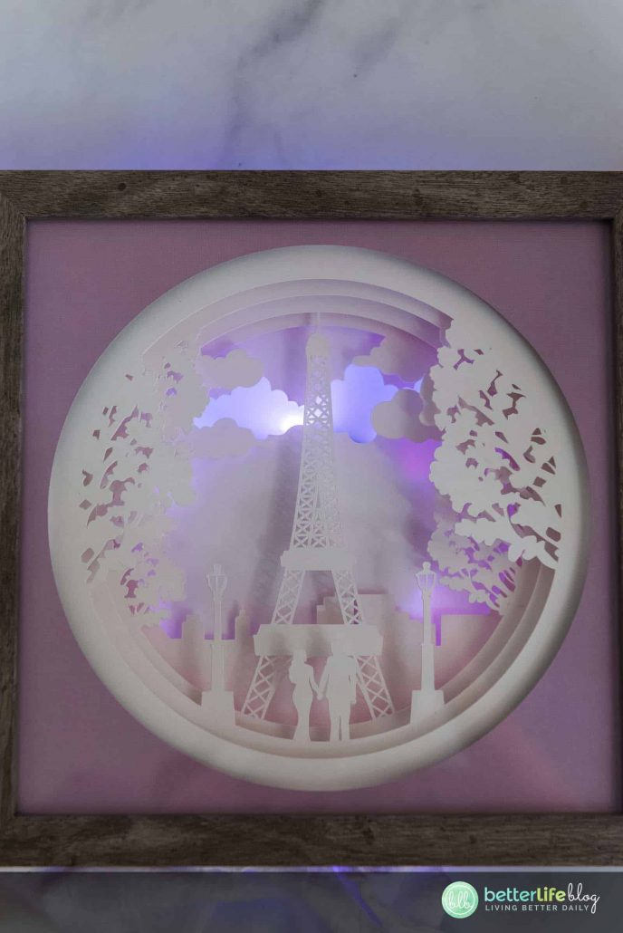 Paris, je t'aime! This beautiful Cricut Paris Shadowbox boasts a gorgeous, intricate design, backed with a glowing LED light. Check out our easy tutorial to learn how to make one of your own.